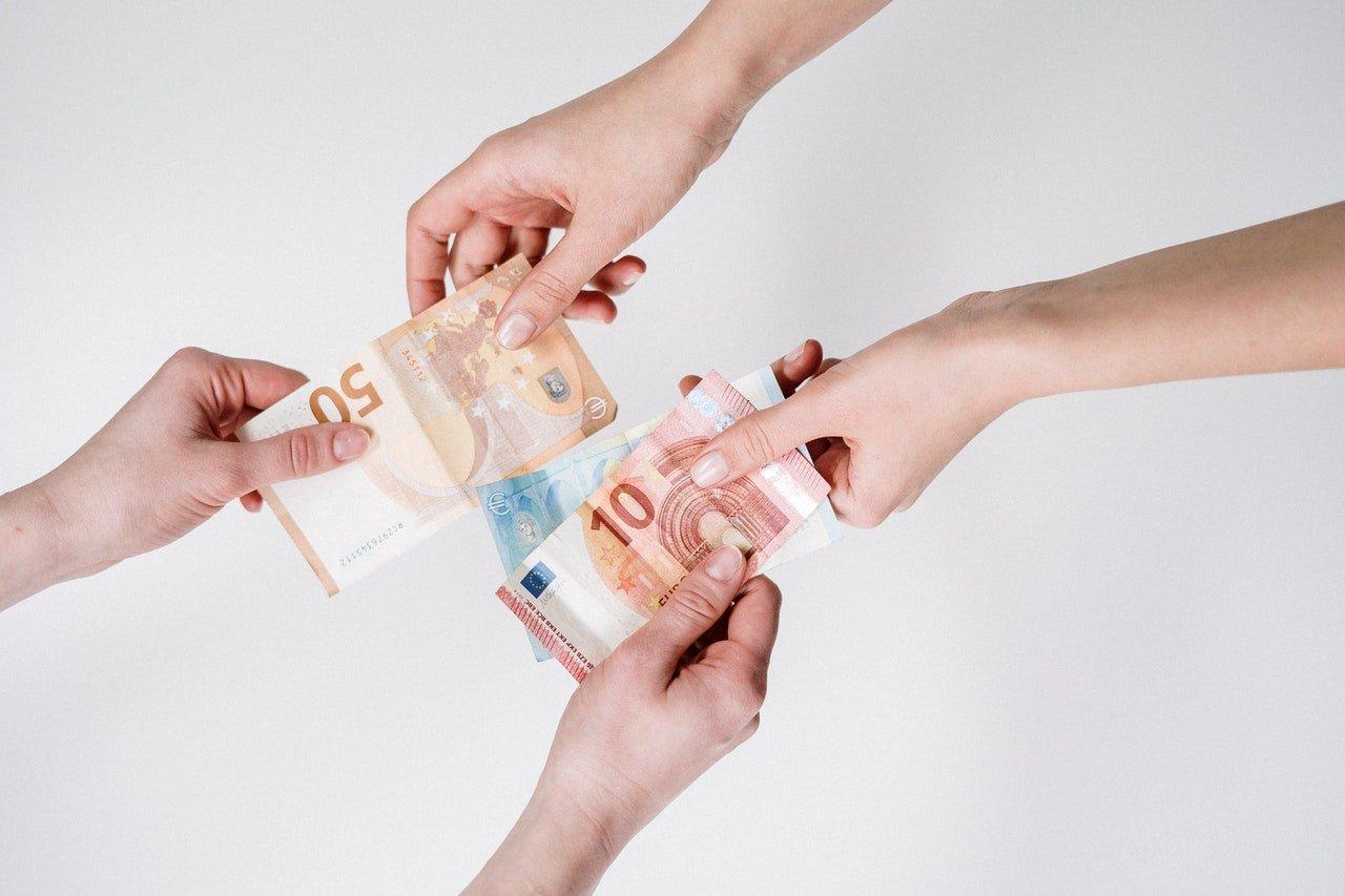 person-holding-10-euro-bill-3943729